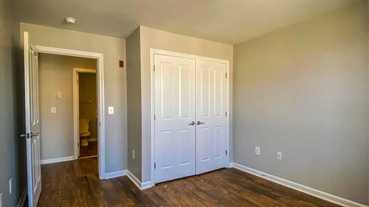 Bedrooms feature large closets and elegant plank flooring.