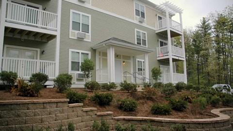 Balconies overlook beautiful tiered landscaping.