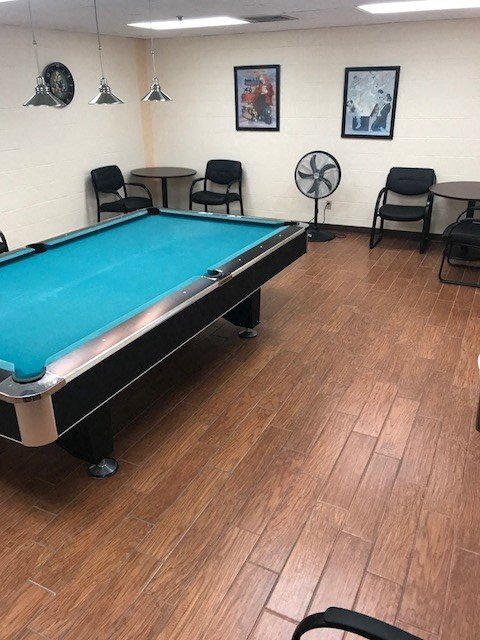 game room with pool table and tables and chairs