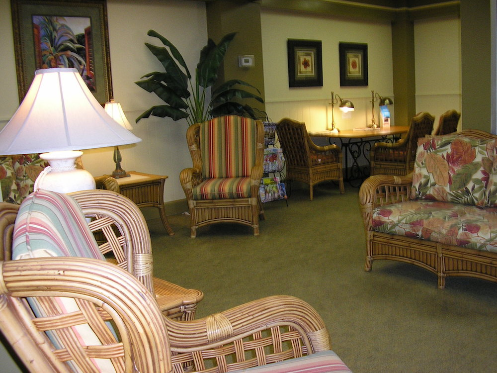 lobby with couches, chairs, lamps, and decor