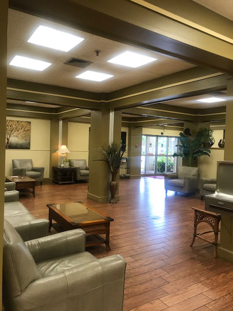 comfortable chairs, sofas, and coffee tables in main lobby