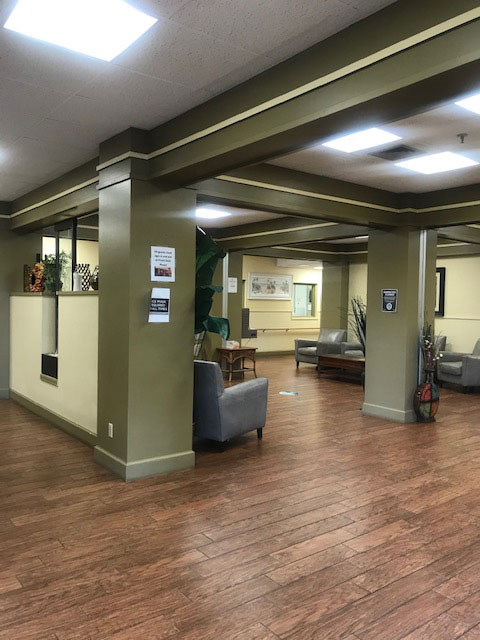 large lobby with hardwood style flooring and overhead lighting
