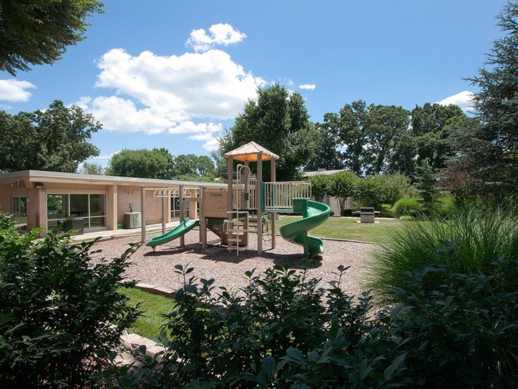 view of play structure for apartment building complex