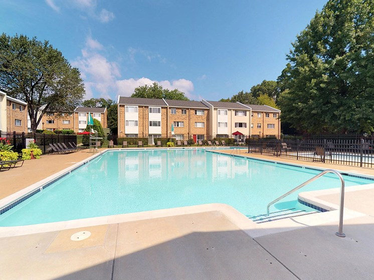 large outdoor pool with sunshine during day