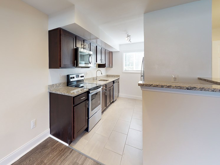 large kitchen area with stainless steel appliances