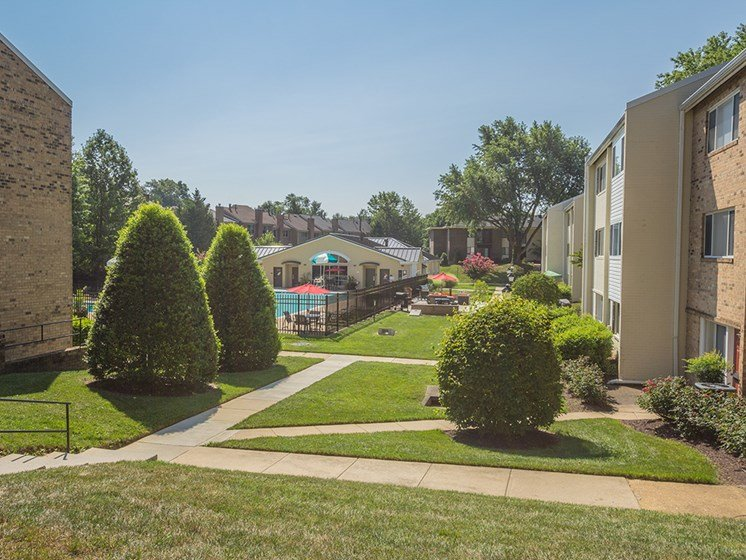 view of exterior landscaping and walkways for apartment complex
