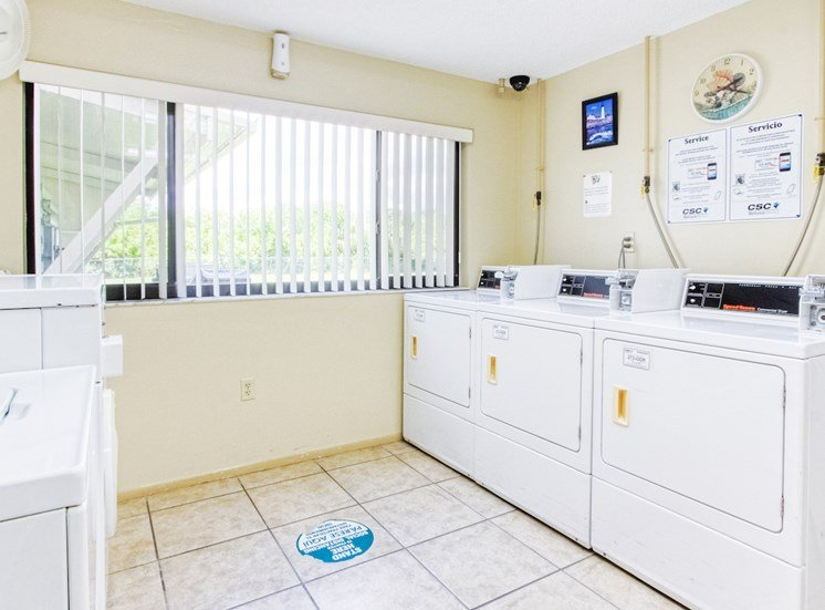 laundry room with washers and dryers