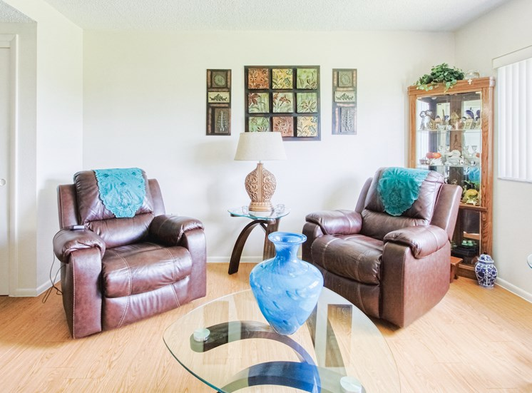 comfortable recliners in living room with hardwood-style flooring