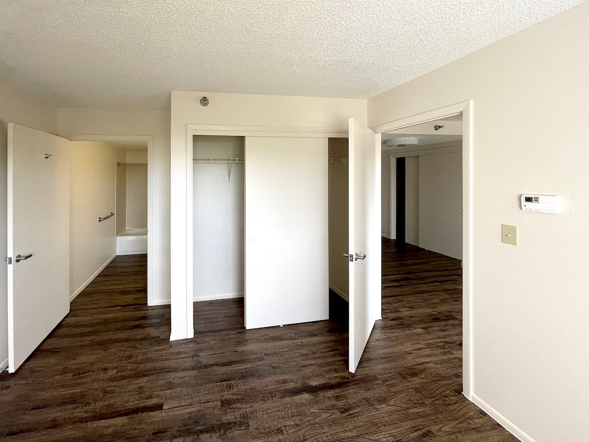 Bedroom with dual closets and bathroom access