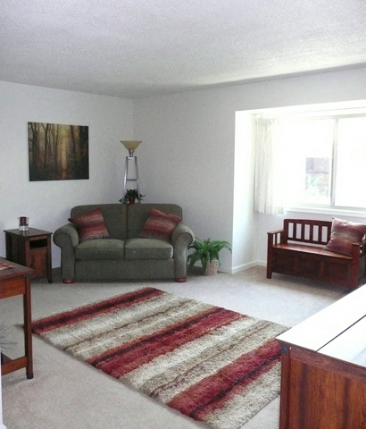 Living Room With Expansive Window at Emerald Court, Iowa