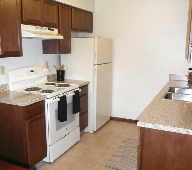 Modern Kitchen With Stainless Steel Appliances And Double Door Refrigerators at Parkside Manor, Coralville, IA