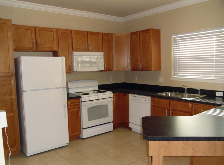 St. Anthony Garden Court apartments in St. Cloud, FL fully-equipped kitchen