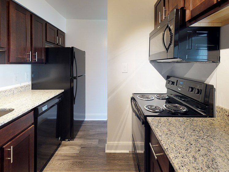 kitchen area with granite counter tops in apartment unit at Gainsborough Court Apartments, Virginia, 22030