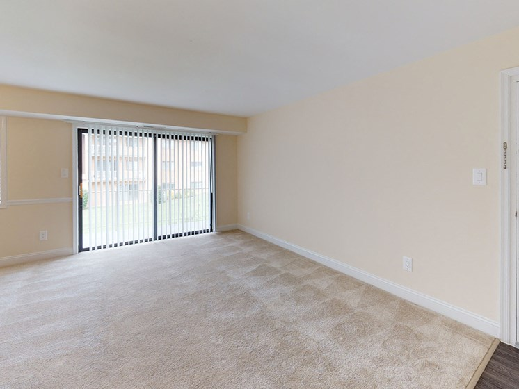 view of large living room area in apartment building with carpeting at Gainsborough Court Apartments, Fairfax, VA, 22030