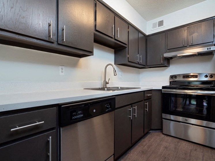The Waverly Kitchen with espresso cabinets and stainless steel finishes