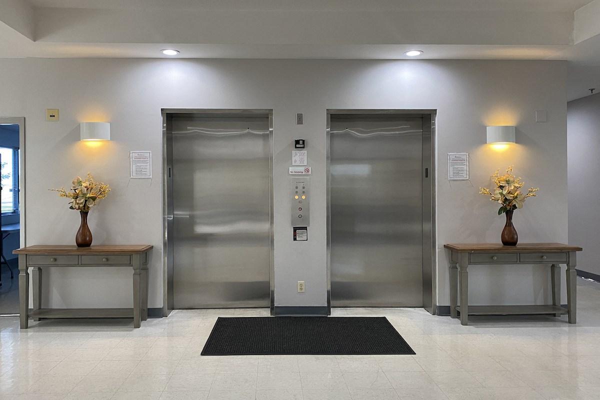 Dual elevators in lobby at Deedco Gardens Senior Apartments