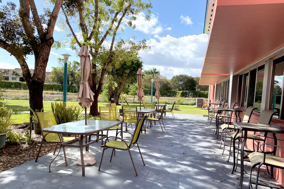 outdoor patio with tables with umbrellas and chairs