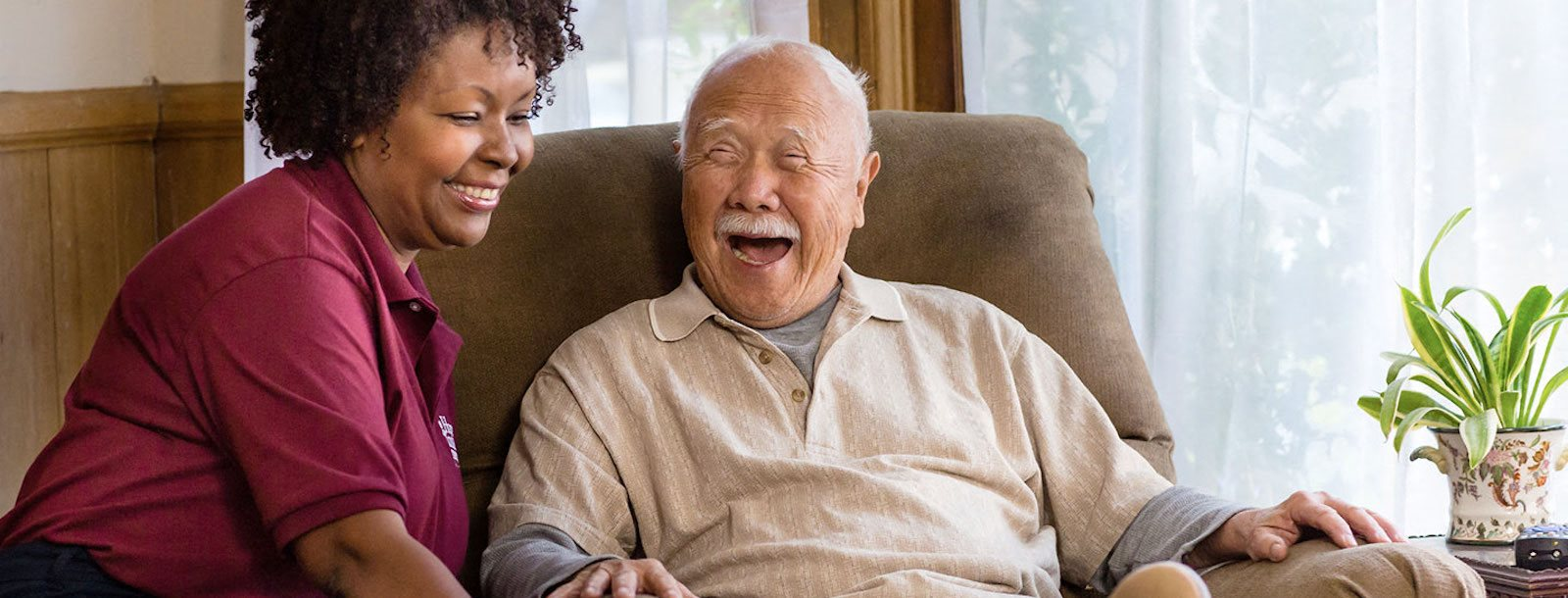 resident and staff member sharing a laugh together