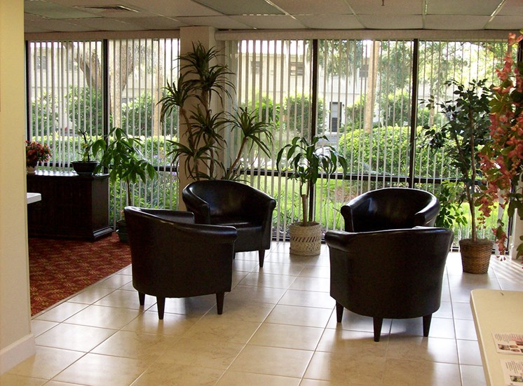 lobby with seating and large windows