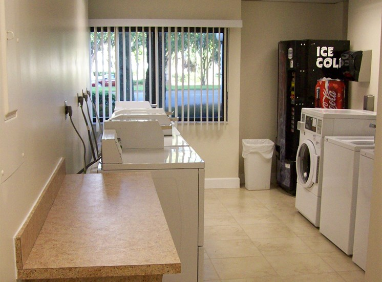 laundry room with drink machine and folding area