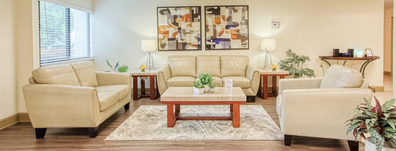 spacious lobby with plush furnishings and nice decor at Orlando Cloisters Senior Apartments