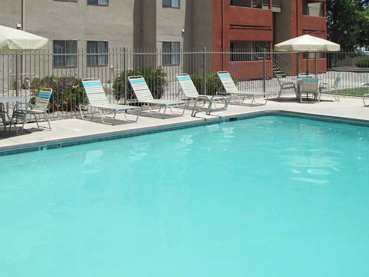 swimming pool with poolside seating