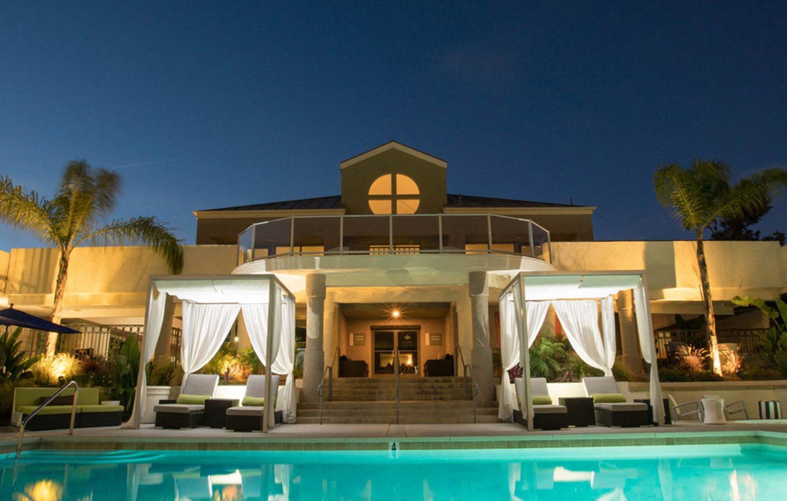 Night time pool with cabanas
