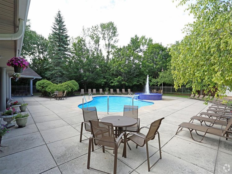 Poolside Relaxing and Tables at Deer Run Apartments, Wisconsin