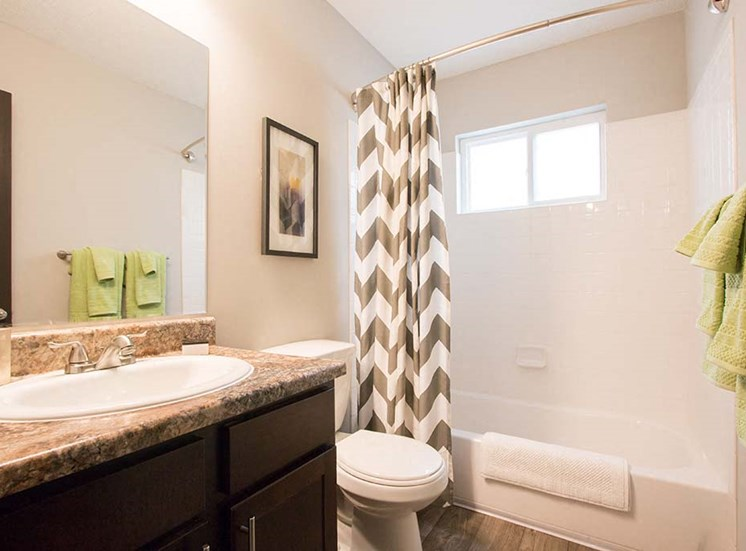 Relax in your bathroom with large soaking tub and shower at Artesian East Village, Atlanta, GA 30316