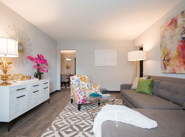 Bright Open Den Living Space with Wood Plank Vinyl Flooring Amble Room for Couches and Furniture at Artesian East Village, Atlanta, GA 30316