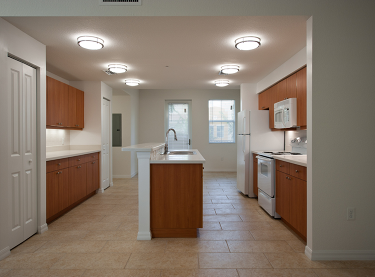 large kitchen with island and overhead lighting