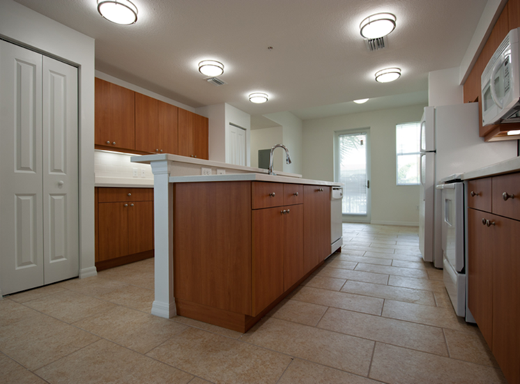 spacious kitchen with island and lots of cabinets
