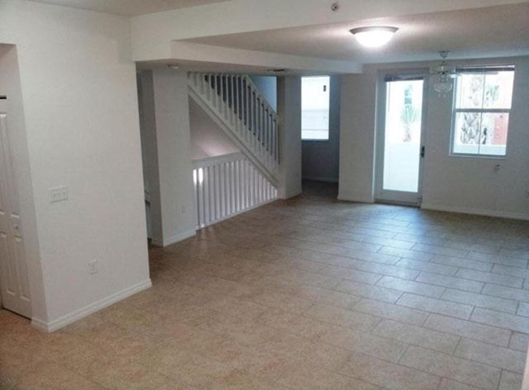 large living room with tile flooring
