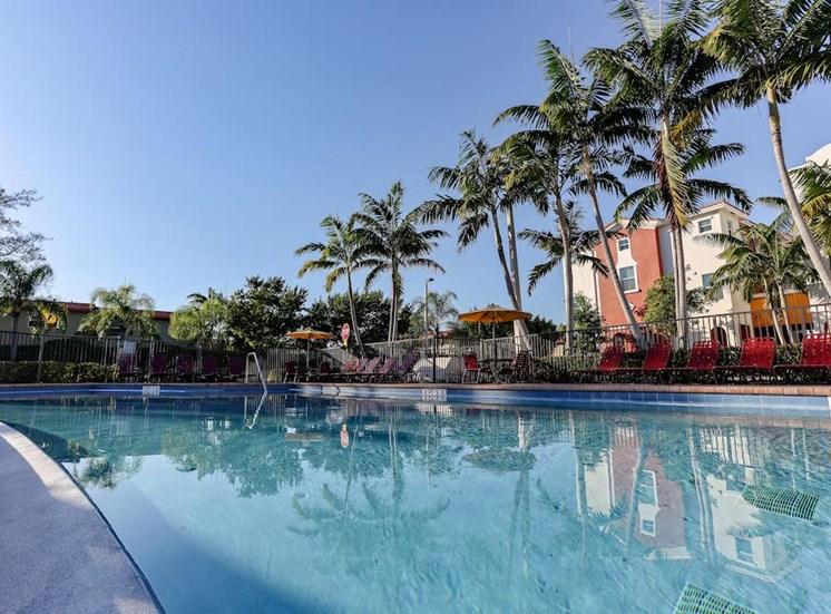 large pool with plenty of lounge furniture