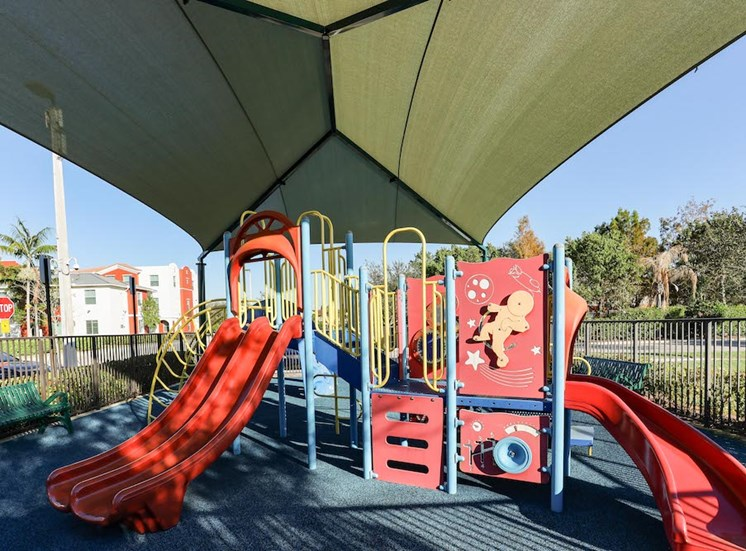 covered playground at East Village Apartments in Davie, FL