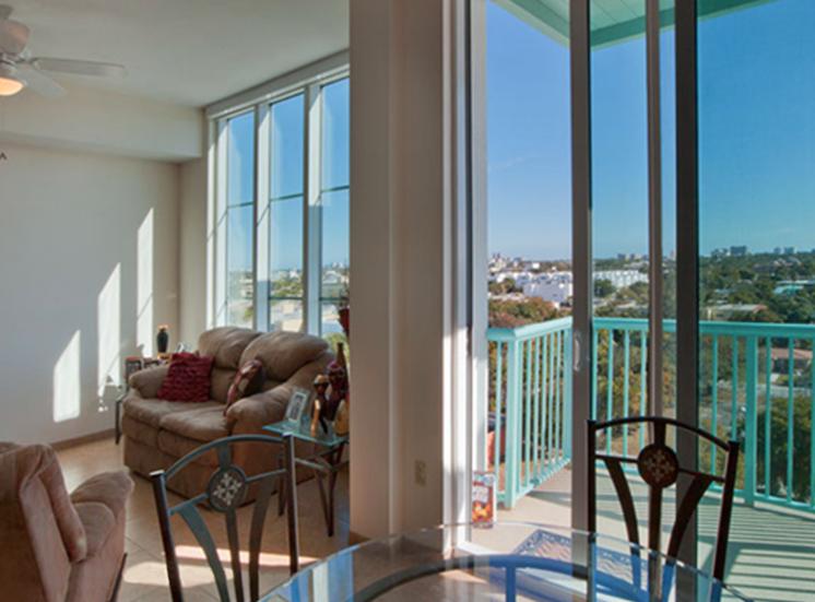 large windows and sliding glass doors leading to balcony