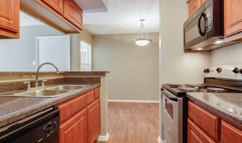 Renovated units include full black appliance package with cherry wood cabinets in select units   Southeast Apartments For Rent   Southpoint Apartments