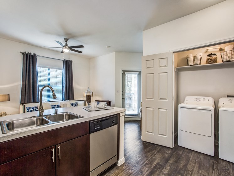 kitchen with side by side laundry room