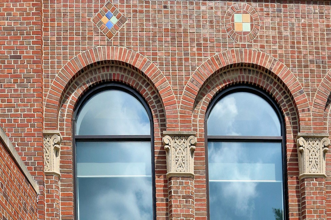 Historic Architecture with large windows at The James senior living in Ferndale, MI