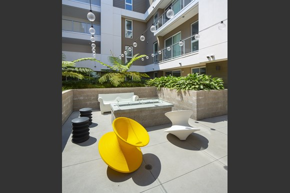 Outdoor courtyard with fire pit at Concourse, Los Angeles, CA, 90045
