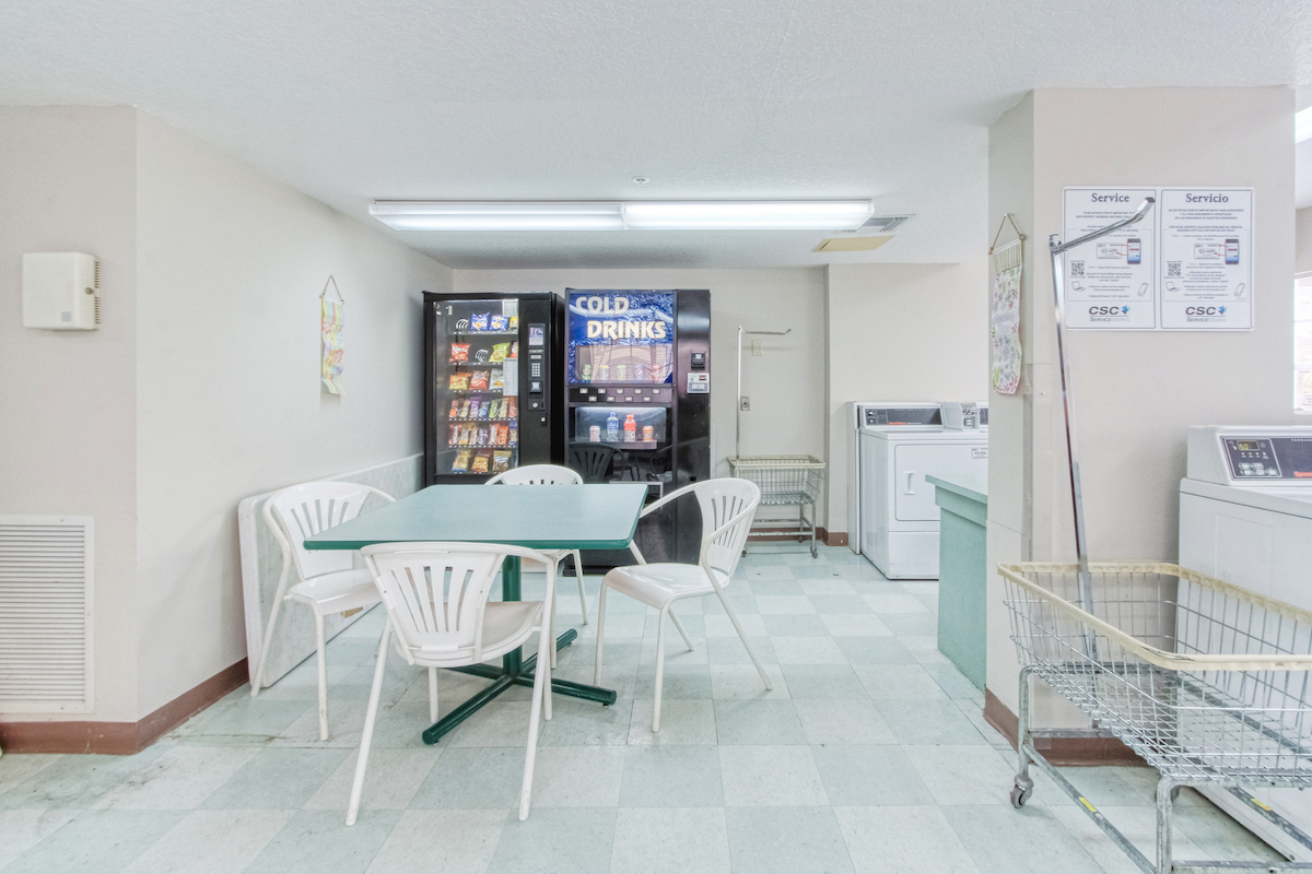 sitting area with drink and snack machines in laundry center