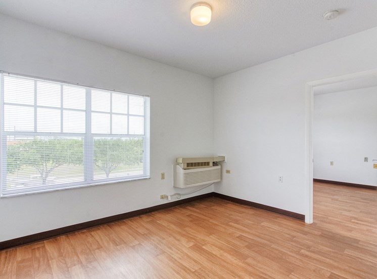 living room with large windows, overhead lighting and AC unit