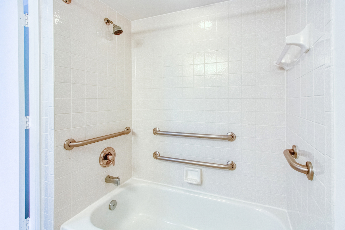 bath and shower with multiple grab bars
