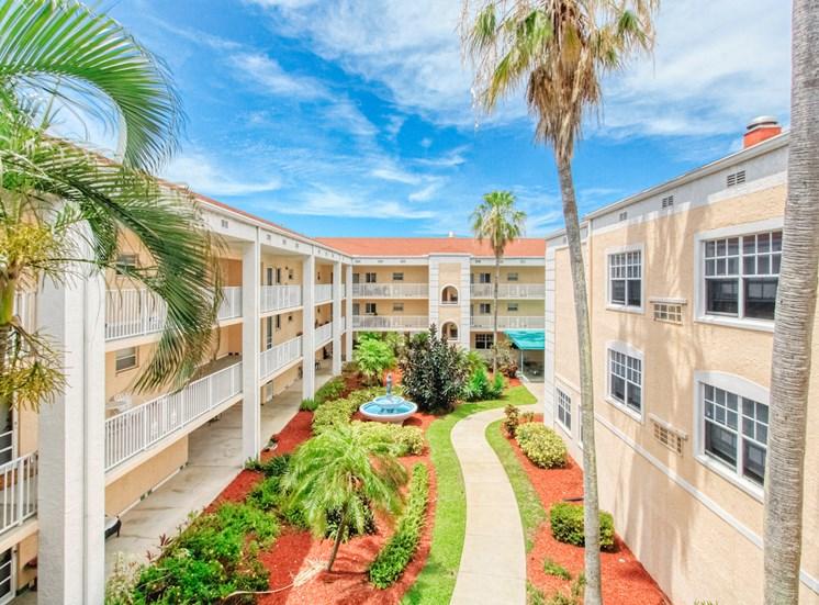 towering palms in courtyard between residential buildings