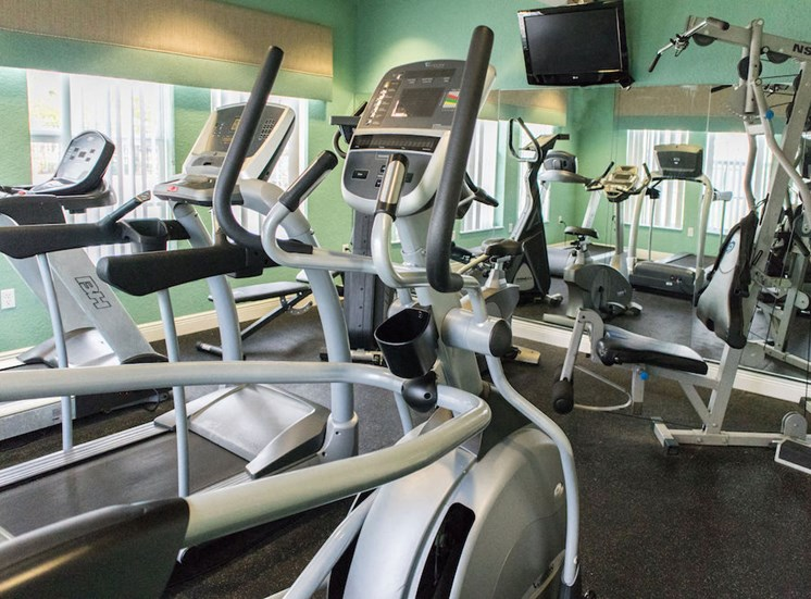fitness center with cardio and weight equipment.