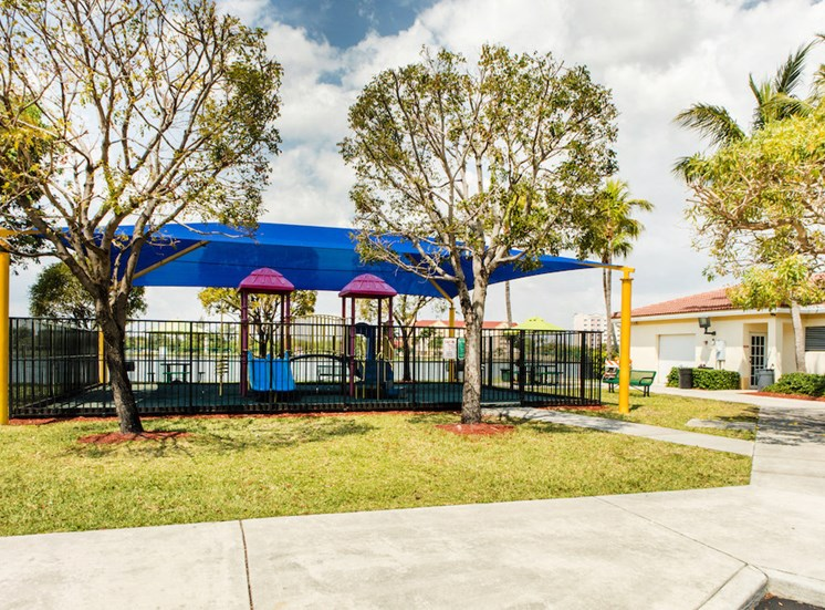 modern fenced playground area at Crystal Lake Apartments