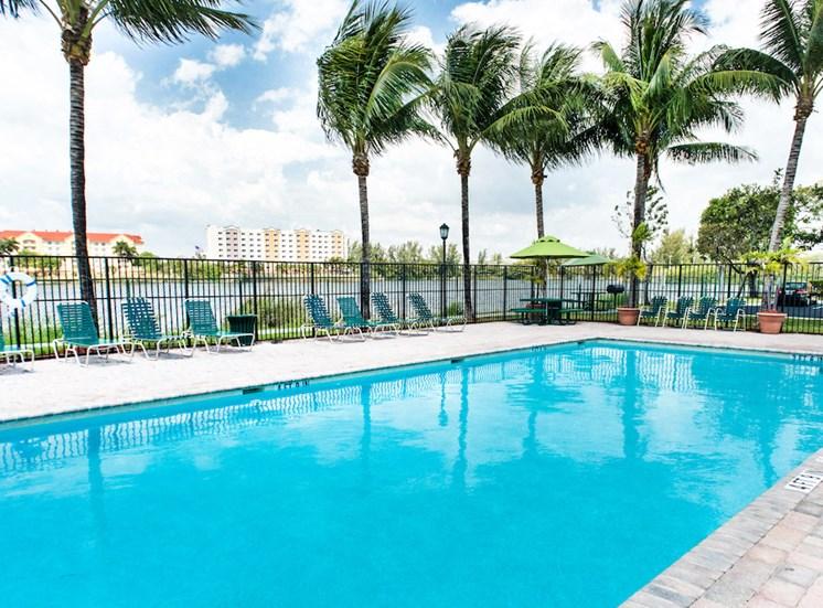 swimming pool with lake views at Crystal Lake Apartments