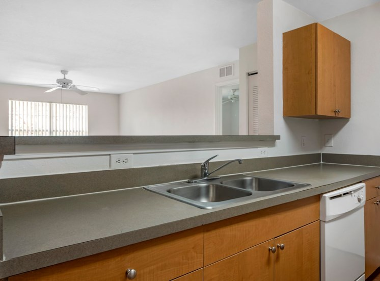 Kitchen with double basin sink and breakfast bar