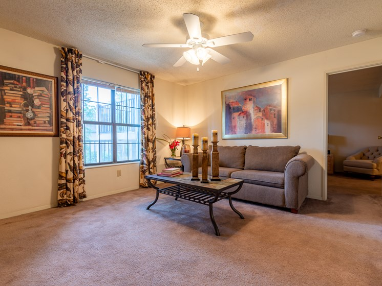 1 Bedroom living room with couch coffee table and window