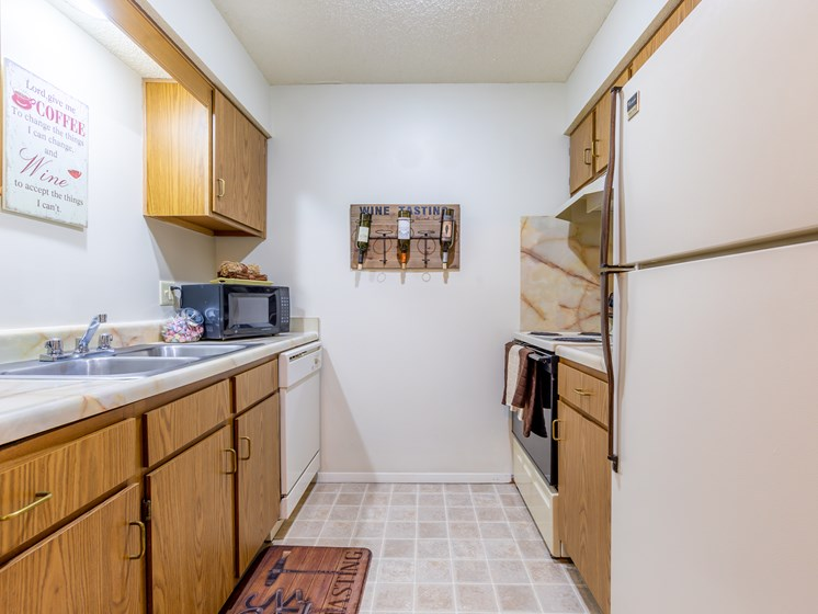 1 Bedroom kitchen with cabinets and refrigerator